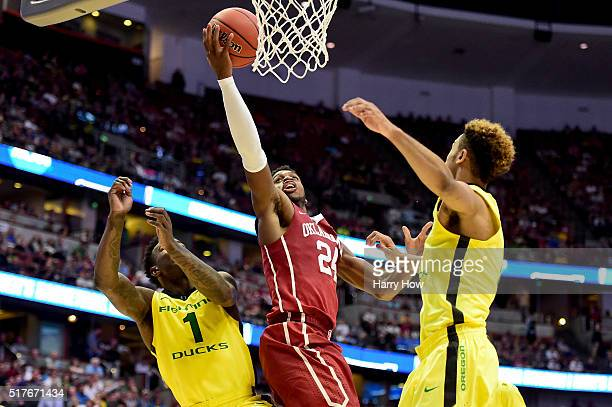 Buddy Hield of the Oklahoma Sooners lays the ball up between Jordan Bell and Tyler Dorsey of the Oregon Ducks in the second half in the NCAA Men's...
