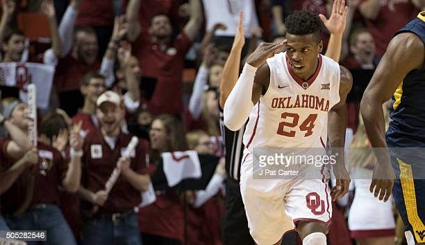 Buddy Hield of the Oklahoma Sooners reacts after making his first two point shot against West Virginia during the first half of a NCAA college...