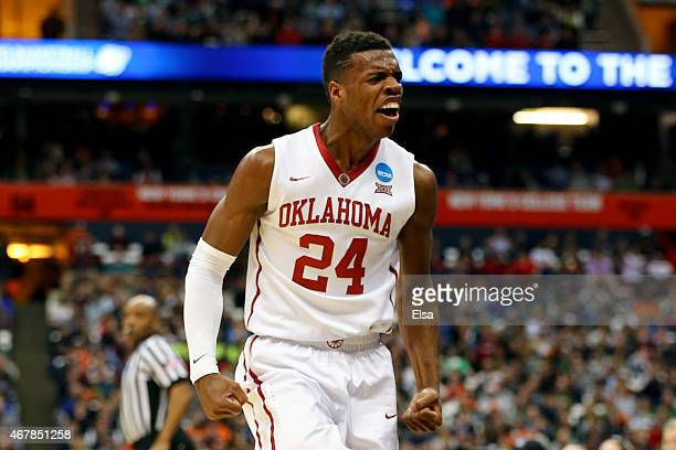 Buddy Hield of the Oklahoma Sooners reacts in the first half of the game against the Michigan State Spartans during the East Regional Semifinal of...