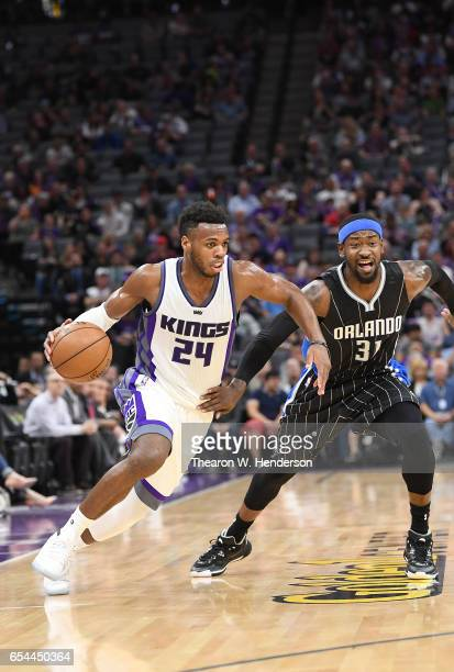 Buddy Hield of the Sacramento Kings drives towards the basket past Terrence Ross of the Orlando Magic during an NBA basketball game at Golden 1...