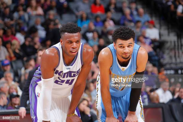Buddy Hield of the Sacramento Kings faces off against Jamal Murray of the Denver Nuggets on February 23 2017 at Golden 1 Center in Sacramento...
