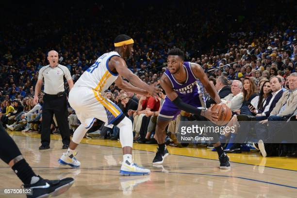 Buddy Hield of the Sacramento Kings handles the ball against the Golden State Warriors on March 24 2017 at ORACLE Arena in Oakland California NOTE TO...