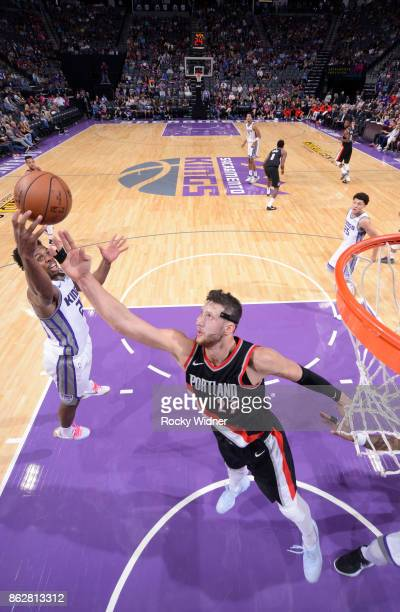 Buddy Hield of the Sacramento Kings rebounds against Jusuf Nurkic of the Portland Trail Blazers on October 9 2017 at Golden 1 Center in Sacramento...