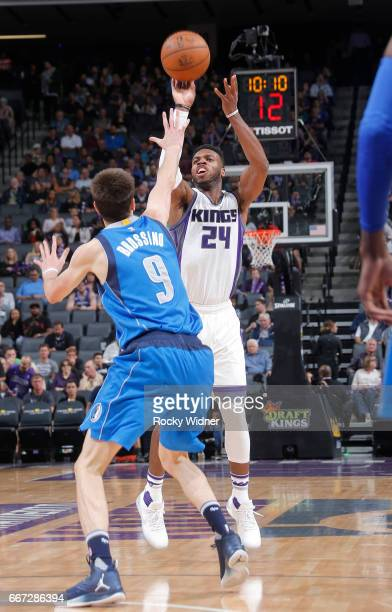 Buddy Hield of the Sacramento Kings shoots against Nicolas Brussino of the Dallas Mavericks on April 4 2017 at Golden 1 Center in Sacramento...