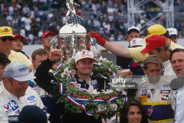 Buddy Lazier is presented with the winner's wreath and trophy after winning the Indy 500 at the Indianapolis Motor Speedway on May 26 1996 in...