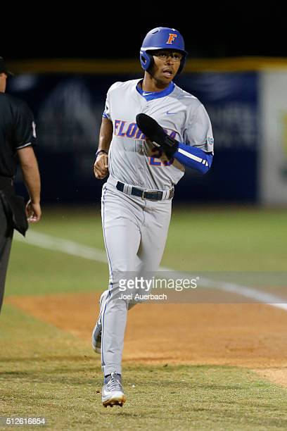 Buddy Reed rounds the bases and scores on a home run hit by Peter Alonso of the Florida Gators against the Miami Hurricanes on February 26 2016 at...