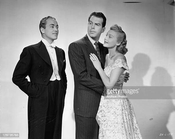 Buddy Rogers watching Fred MacMurray holding Madeleine Carroll in a scene from the film 'An Innocent Affair' 1948