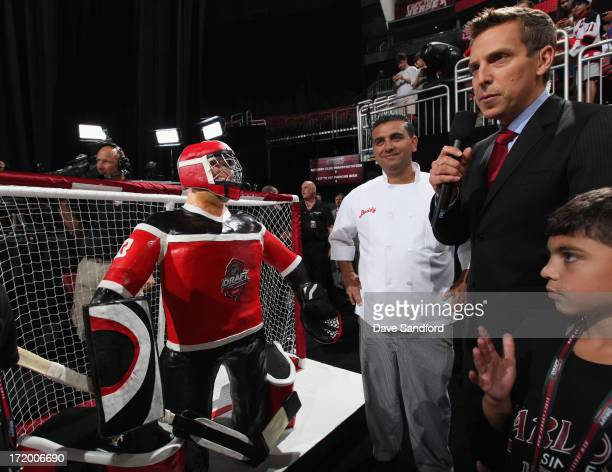 Buddy Valastro aka the Cake Boss presents his cake with TSN sportscaster James Duthie before the start of the 2013 NHL Draft at Prudential Center on...
