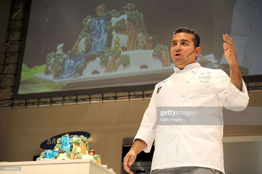 <a gi-track='captionPersonalityLinkClicked' href=/galleries/search?phrase=Buddy+Valastro&family=editorial&specificpeople=5810322 ng-click='$event.stopPropagation()'>Buddy Valastro</a>, star of the television programme 'The Cake Boss' during a presentation at the Good Food and Wine show in on May 25, 2012 in Cape Town, South Africa.
