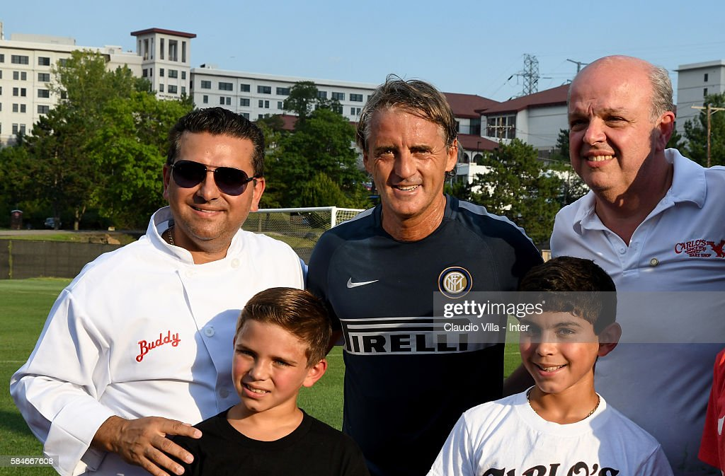 Buddy Valestro head coach FC Internazionale Roberto Mancini and Mauro Castano pose for a photo after the FC Internazionale training session at...