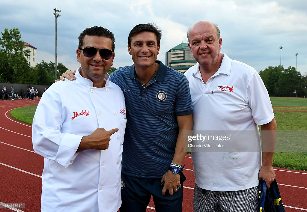Buddy Valestro Vice President FC Internazionale Javier Zanetti and Mauro Castano pose for a photo after the FC Internazionale training session at...