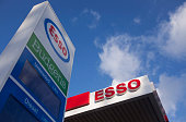 A Budgens logo sits above a broken electronic fuel price display on a sign outside an Esso gas station operated by Exxon Mobil Corp in Guildford UK...