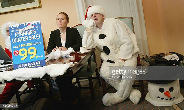 Budget airline Ryanair's Chief Executive Michael O'Leary addresses a press conference dressed in a snowman costume on July 8 2004 in London England...