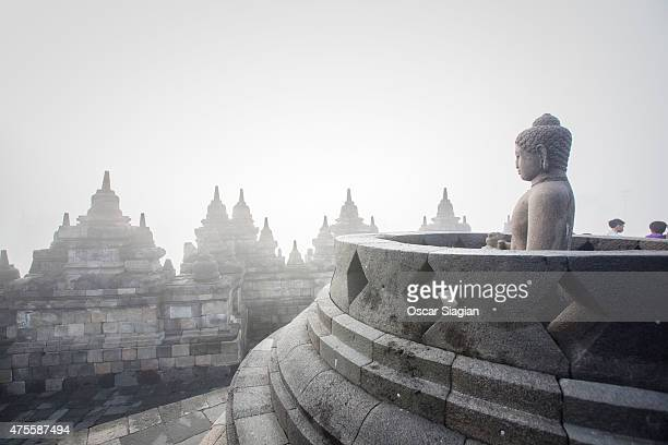 Budha statue at Borobudur Temple on June 2 2015 in Magelang Indonesia Buddhists in Indonesia celebrate Vesak at the monument anually which makes it...
