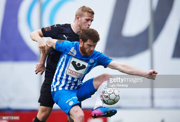 Budu Zivzivadze of Esbjerg fB and Jonas Bager of Randers FC compete for the ball during the Danish Alka Superliga match between Esbjerg fB and...