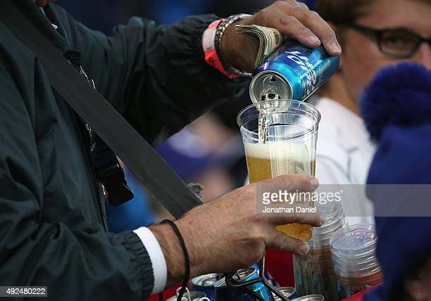Budweiser vendor pours a beer prior to game four of the National League Division Series between the Chicago Cubs and the St Louis Cardinals at...