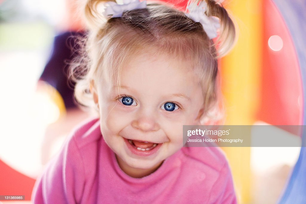 Bue-eyed toddler girl at park : Stock Photo