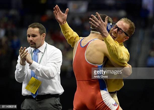 Buena Vista wrestling coach Jared Todd right celebrates with his wrestler Sabyn Diamond after Diamond defeated Reagan Lane from Eads in the 2A 160lb...