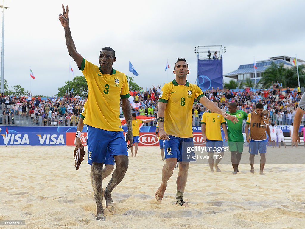 Bueno and <a gi-track='captionPersonalityLinkClicked' href=/galleries/search?phrase=Bruno+Xavier&family=editorial&specificpeople=8674132 ng-click='$event.stopPropagation()'>Bruno Xavier</a> of Brazil celebrate at the end of the FIFA Beach Soccer World Cup Tahiti 2013 Quarter Final match between Brazil and Japan at the Tahua To'ata Stadium on September 25, 2013 in Papeete, French Polynesia.