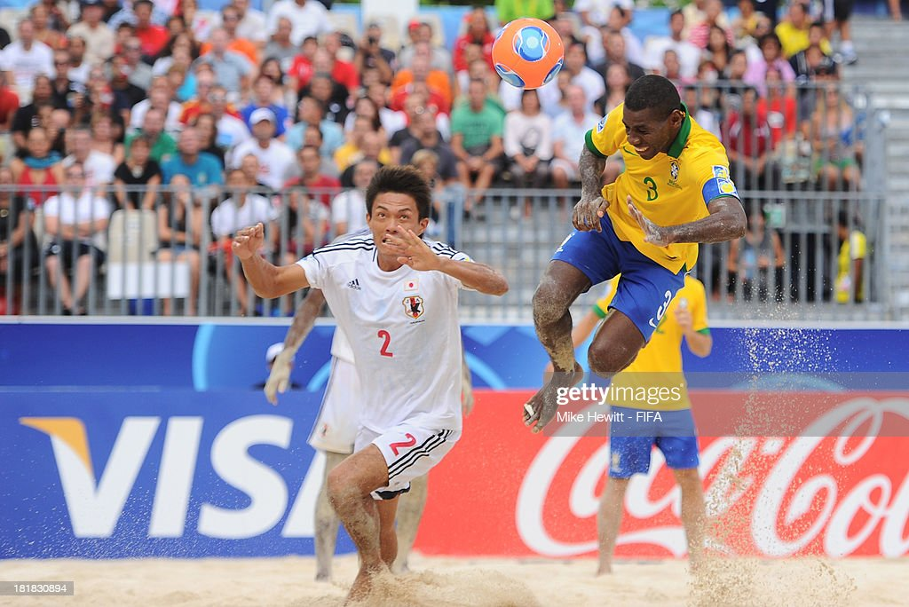 Bueno of Brazil scores the winning goal as Keisuke Matsuda of Japan tries to challenge during the FIFA Beach Soccer World Cup Tahiti 2013 Quarter Final match between Brazil and Japan at the Tahua To'ata Stadium on September 25, 2013 in Papeete, French Polynesia.