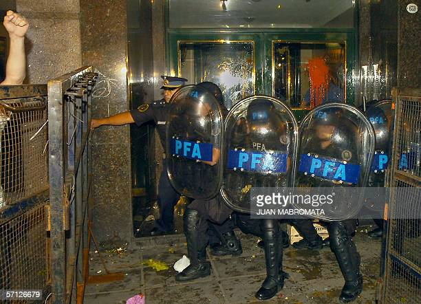 Argentine Federal Policemen protect the entrance of the residence of Argentina's former dictator Gen Rafael Videla who is under house arrest for...