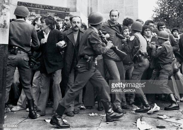 Argentine soccer fans are beaten in front of the Banco de la Nacion Argentina in Buenos Aires by police who considered that they were not orderly...