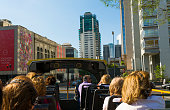 Buenos Aires Argentina double decker tourist bus with people traveling around city sites