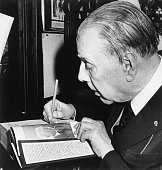 Buenos Aires Argentina Jorge Luis Borges Argentina's best known author autographs one of his books Borges who recently celebrated his 85th birthday...