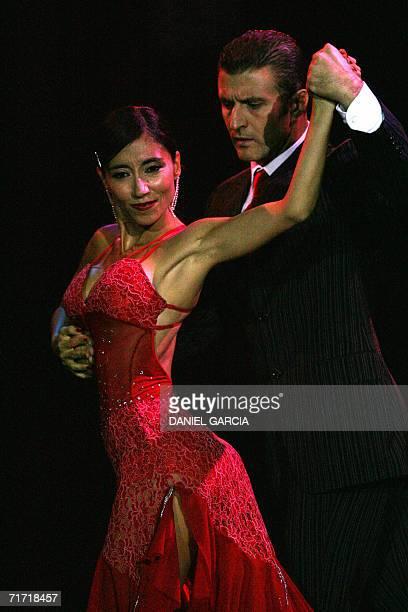 Paola Perez and Donato Cuocolo a couple from Italy dance the tango 'El internado' during the semifinal of the Tango Escenario competition in Buenos...