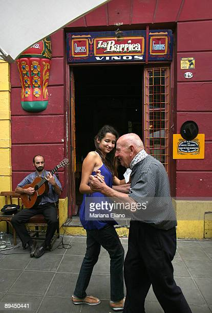 Buenos Aires Argentina Street in La Boca La Boca is a typical neighborhood with irregular streets and high paths that protect the housings of...