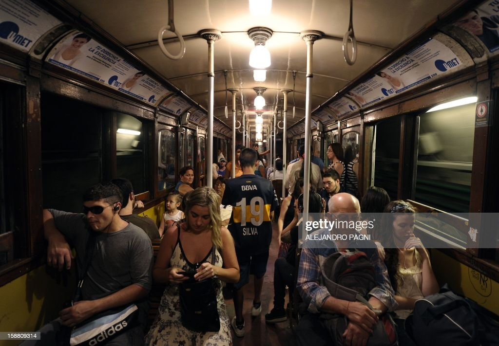 Buenos Aires city-dwellers and tourists travel in one of the historic wagons of La Brugeoise of the subway Line A which is expected to be close soon following a decision by city mayor Mauricio Macri to replace the fleet with Chinese-made wagons, in Buenos Aires, on December 29, 2012. Line A was the first subway line to work in the southern hemisphere and its trains are among the ten oldest still working daily. The La Brugeoise wagons were constructed between 1912 and 1919 by La Brugeoise et Nicaise et Delcuve in Belgium.