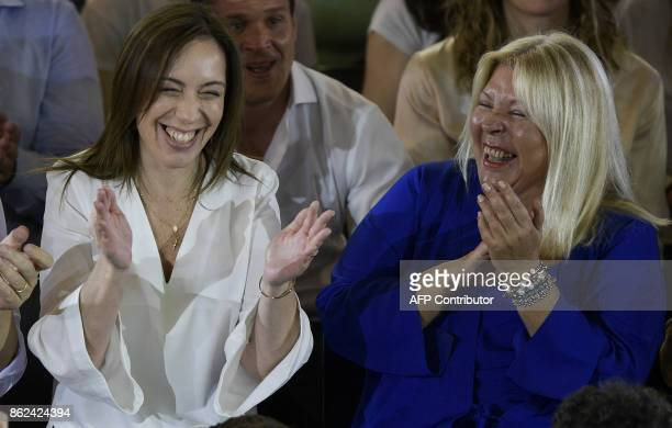 Buenos Aires Governor Maria Eugenia Vidal and Cambiemos party legislator candidate for Buenos Aires city Elisa Carrio laugh in Buenos Aires on...