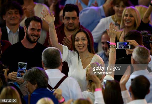 Buenos Aires Governor Maria Eugenia Vidal waves surrrounded by supporters in Buenos Aires on October 17 2017 during the closure campaign of the...