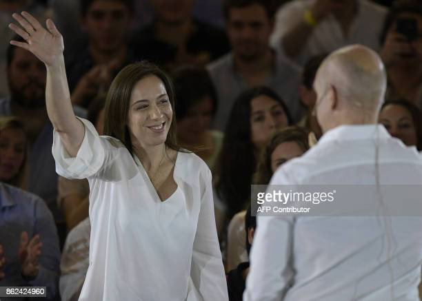 Buenos Aires Governor Maria Eugenia Vidal waves while Buenos Aires Mayor Horacio Rodriguez Larreta delivers a speech in Buenos Aires on October 17...