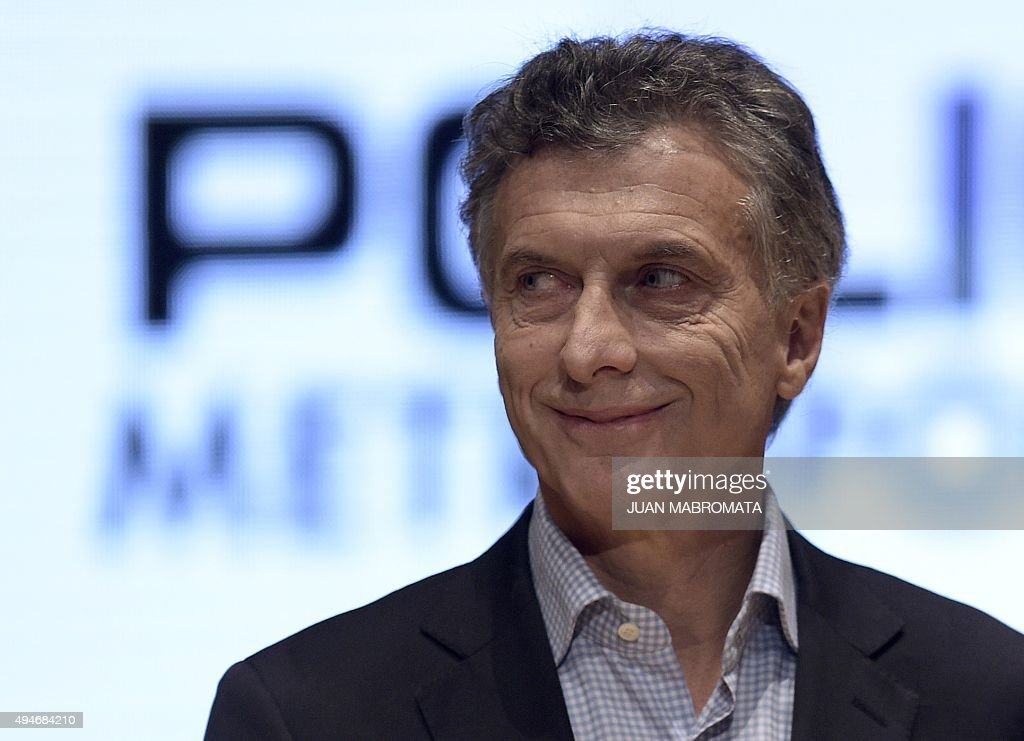 Buenos Aires Mayor and presidential candidate for 'Cambiemos' party <a gi-track='captionPersonalityLinkClicked' href=/galleries/search?phrase=Mauricio+Macri&family=editorial&specificpeople=773012 ng-click='$event.stopPropagation()'>Mauricio Macri</a> gestures as he attends the 7th anniversary of the Metropolitan Police in Buenos Aires on October 28, 2015. Argentina's presidential election is headed for a November 22 runoff between incumbent Cristina Kirchner's chosen successor Daniel Scioli and conservative rival <a gi-track='captionPersonalityLinkClicked' href=/galleries/search?phrase=Mauricio+Macri&family=editorial&specificpeople=773012 ng-click='$event.stopPropagation()'>Mauricio Macri</a>. AFP PHOTO / JUAN MABROMATA
