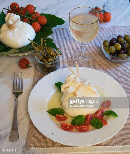 Bufala's Mozzarella cheese on a plate with tomatoe