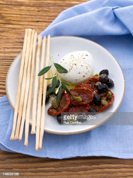 Buffallo mozzarella with grissini, capers, dried tomatoes and olives