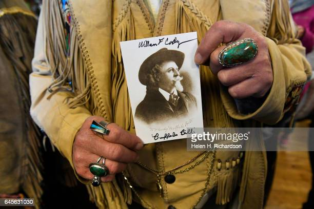 Buffalo Bill impersonators Buzz Baker holds up a collector's photo of the real William 'Buffalo Bill' Cody during celebrations of the 100th...