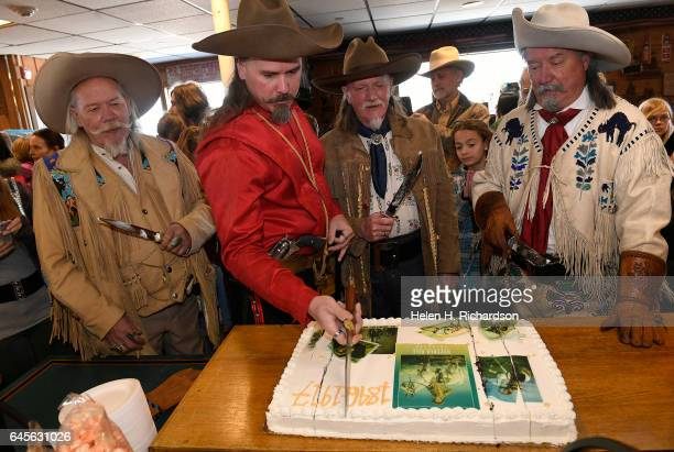 Buffalo Bill impersonators from left to right Buzz Baker Jason Baker Stanley Beug second from right and RD Melfi right cut the anniversary cake as...