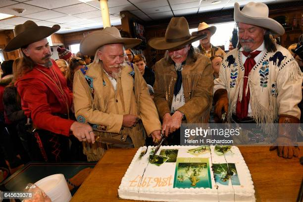 Buffalo Bill impersonators from left to right Jason Baker Buzz Baker Stanley Beug second from right and RD Melfi right cut the anniversary cake as...