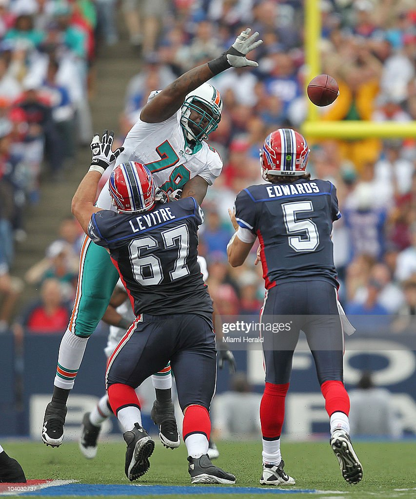 Buffalo Bills' Andy Levite blocks Miami Dolphins defensive tackle Tony McDaniel, who applies pressure on Dolphins quarterback Trent Edwards during the fourth quarter at Ralph Wilson Stadium in Buffalo, New York on Sunday, September 12, 2010.