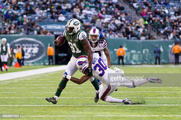 Buffalo Bills Cornerback Corey White tackles New York Jets Wide Receiver Quincy Enunwa during the second half of a regular season NFL game between...