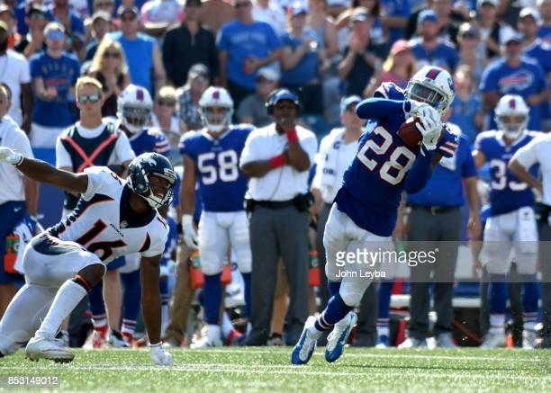 Buffalo Bills cornerback EJ Gaines intercepts a pass in from of Denver Broncos wide receiver Bennie Fowler late in the fourth quarter on September 24...