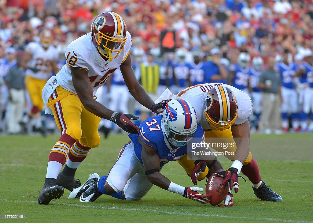 Buffalo Bills defensive back Nickell Robey (37) fumbles a punt return as Washington Redskins wide receiver Lance Lewis (18) and Washington Redskins linebacker Vic So'oto (58) defend on the play in the third quarter during a preseason game between the Buffalo Bills and the Washington Redskins at FedEx Field on August 24, 2013 in Landover, Md. Washington Redskins wide receiver Lance Lewis (18) recovered the ball which led to a field goal helping the Redskins beat the Bills 30-7.