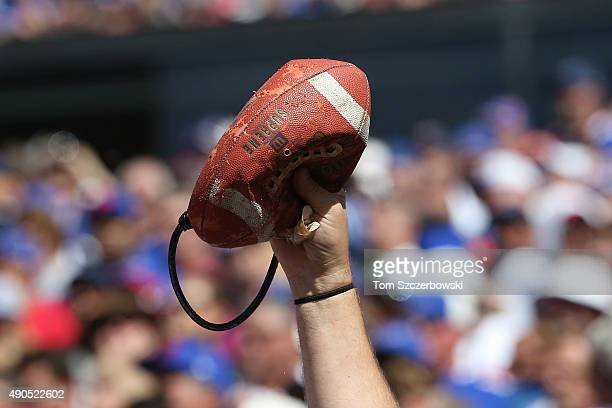 Buffalo Bills fan holds a deflated football mocking the New England Patriots during NFL game action at Ralph Wilson Stadium on September 20 2015 in...