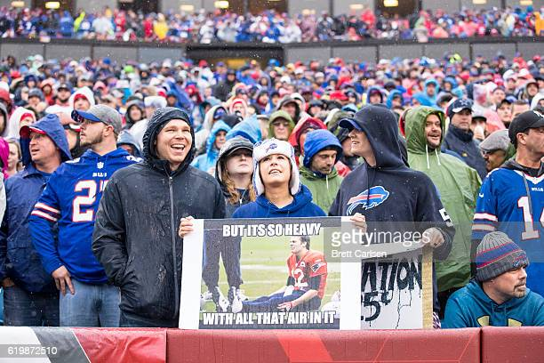 Buffalo Bills fans hold a sign teasing Tom Brady of the New England Patriots during the game against the Buffalo Bills on October 30 2016 at New Era...