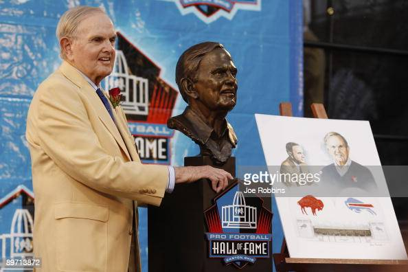 Buffalo Bills founder Ralph Wilson Jr poses with his bust at his induction into the Pro Football Hall of Fame during the 2009 enshrinement ceremony...