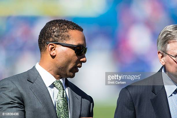 Buffalo Bills General Manager Doug Whaley speaks with team owner Terry Pegula before the game against the Arizona Cardinals on September 25 2016 at...