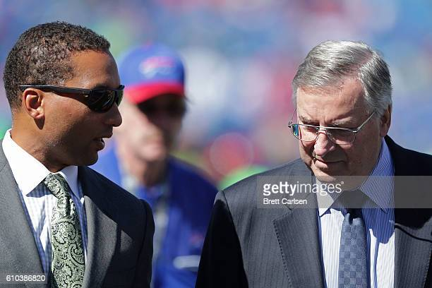 Buffalo Bills General Manager Doug Whaley talks with Buffalo Bills owner Terry Pegula before the game against the Arizona Cardinals at New Era Field...