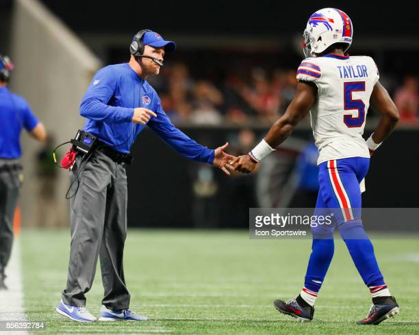 Buffalo Bills head coach Sean McDermott shakes hands with quarterback Tyrod Taylor during an NFL football game between the Buffalo Bills and the...